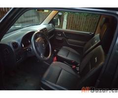 Suzuki Jimny 4x4 1.3i TOP